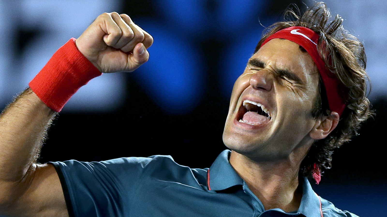 Roger Federer of Switzerland celebrates after defeating Andy Murray of Britain during their quarterfinal at the Australian Open tennis championship in Melbourne, Australia, Wednesday, Jan. 22, 2014.(AP Photo/Aaron Favila)