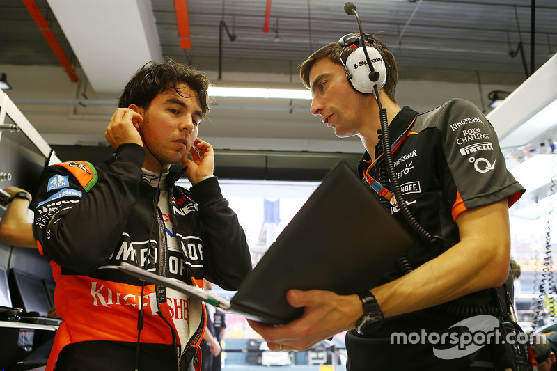 (L to R): Sergio Perez (MEX) Sahara Force India F1 with Tim Wright (GBR) Sahara Force India F1 Team Race Engineer. 18.09.2015. Formula 1 World Championship, Rd 13, Singapore Grand Prix, Singapore, Singapore, Practice Day. - www.xpbimages.com, EMail: requests@xpbimages.com - copy of publication required for printed pictures. Every used picture is fee-liable. © Copyright: Batchelor / XPB Images