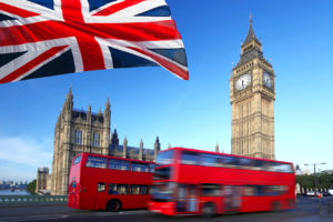 Big Ben with city bus and flag of England, London