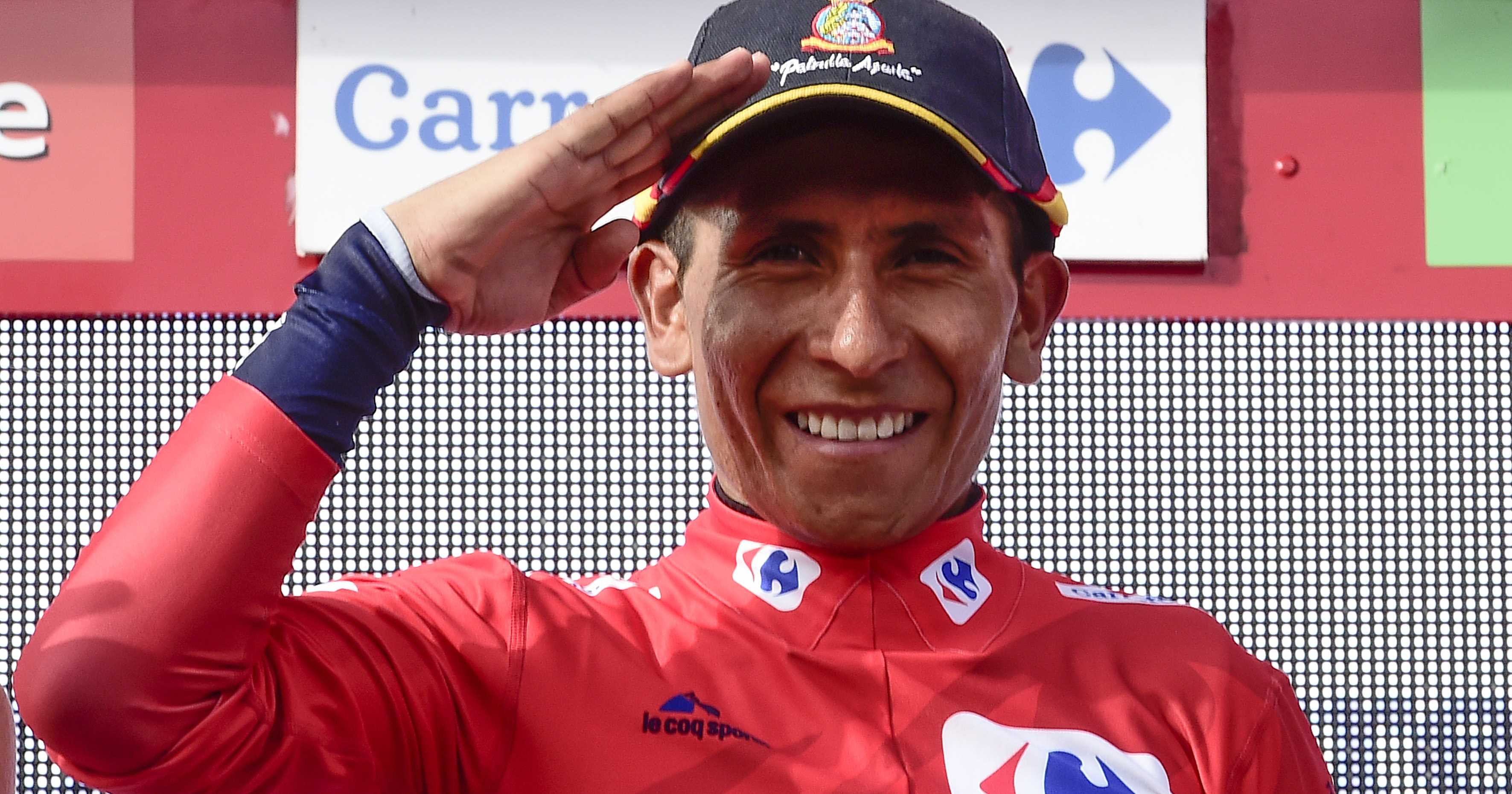 "Movistar's Colombian cyclist Nairo Quintana gestures as he celebrates on the podium retaining the red jersey after 20th stage of the 71st edition of ""La Vuelta"" Tour of Spain, a 184km route Benidorm to Alto de Aitana, on September 10, 2016. / AFP PHOTO / JOSE JORDAN"